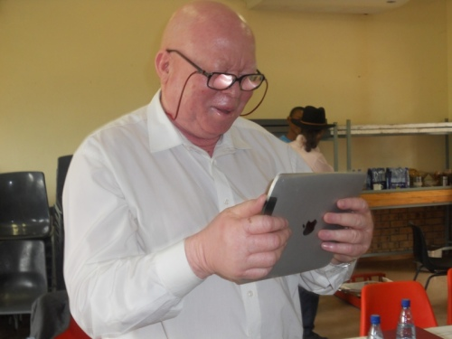 School principal checking out the accessibility features of the iPad