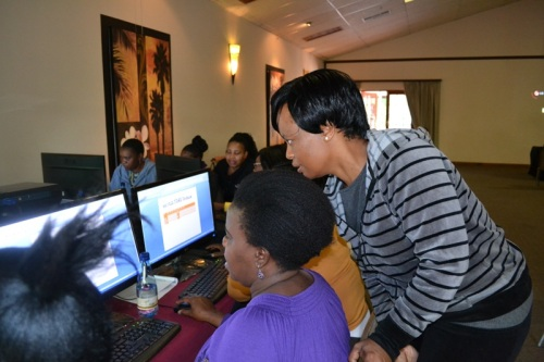 Rolda from LIMDEV working with participants requesting basic computer training